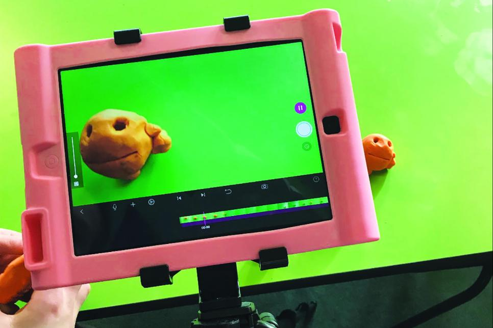 Image of an ipad capturing a plasticine figure.